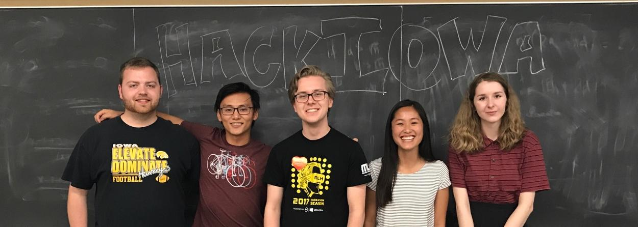 Picture of HackIowa Officers. Left to Right: Harley Waldstein (Treasurer), Thomas Han (Vice President), Kevin Blicharski (President), Olivia Sandvold (Social Chair), and Madeline Silva (Communications Director).